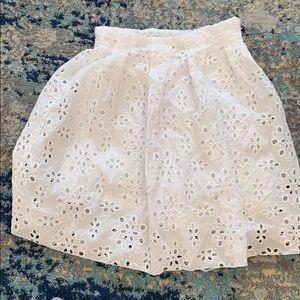 Beautiful white skirt with eyelit detail.